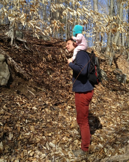 Our youngest on her father's shoulders on an early spring hike.
